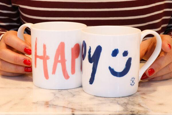 Happy hand drawn brush stroke design on bone china mug
